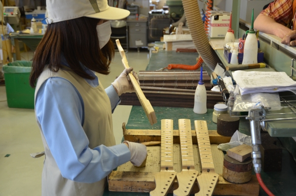 Filling the fret ends.