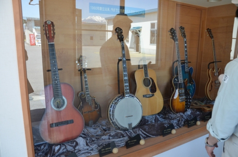 © Some of the historic Fujigen guitars, including one of the first acoustic models dating to the early 1960s.